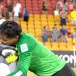 China's keeper asks Aussie ball boy for penalty advice, hugs him for getting it right
