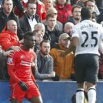 Liverpool fans had to hold Mario Balotelli back from a confrontation with Chris Smalling