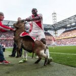 Cologne's Anthony Ujah celebrates goal by assaulting a live goat