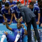 Didier Drogba gets carried off by his teammates in his final match with the club