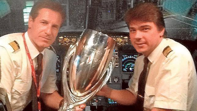 Boned, left, with the UEFA Super Cup and co-pilot Alejandro Buxonet. (ABC)