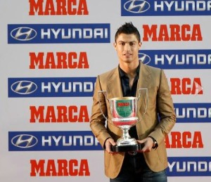 An empty-eyed Ronaldo with a soulless smile, collecting his award for top goalscorer but knowing he will fall short in the Balon D'or race yet again