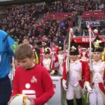Cologne escorted onto pitch by rifle carrying child soldiers