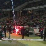 Wolfsburg fans launch flare into Hannover's dugout