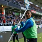 Malmo player throws corner flag at opposing fans after they throw explosive at him