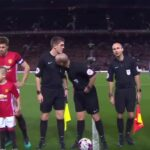 Mike Dean sniffs assistant referee before Manchester derby