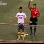 Player in Guam gets booked for celebrating goal by removing shirt for marriage proposal
