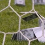 Milan fans throw fake money at Donnarumma during international match